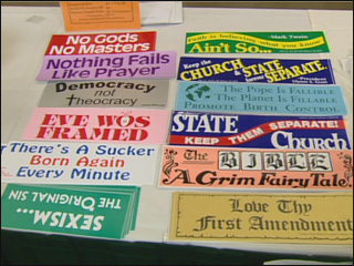 A selection of bumper stickers is available for sale at the Freedom From Religion convention.